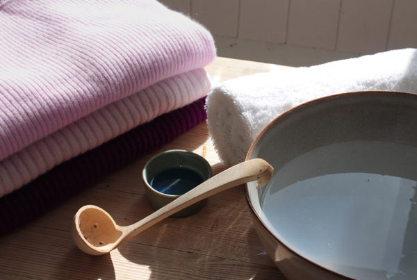 Image of clothes with a bowl of water besides