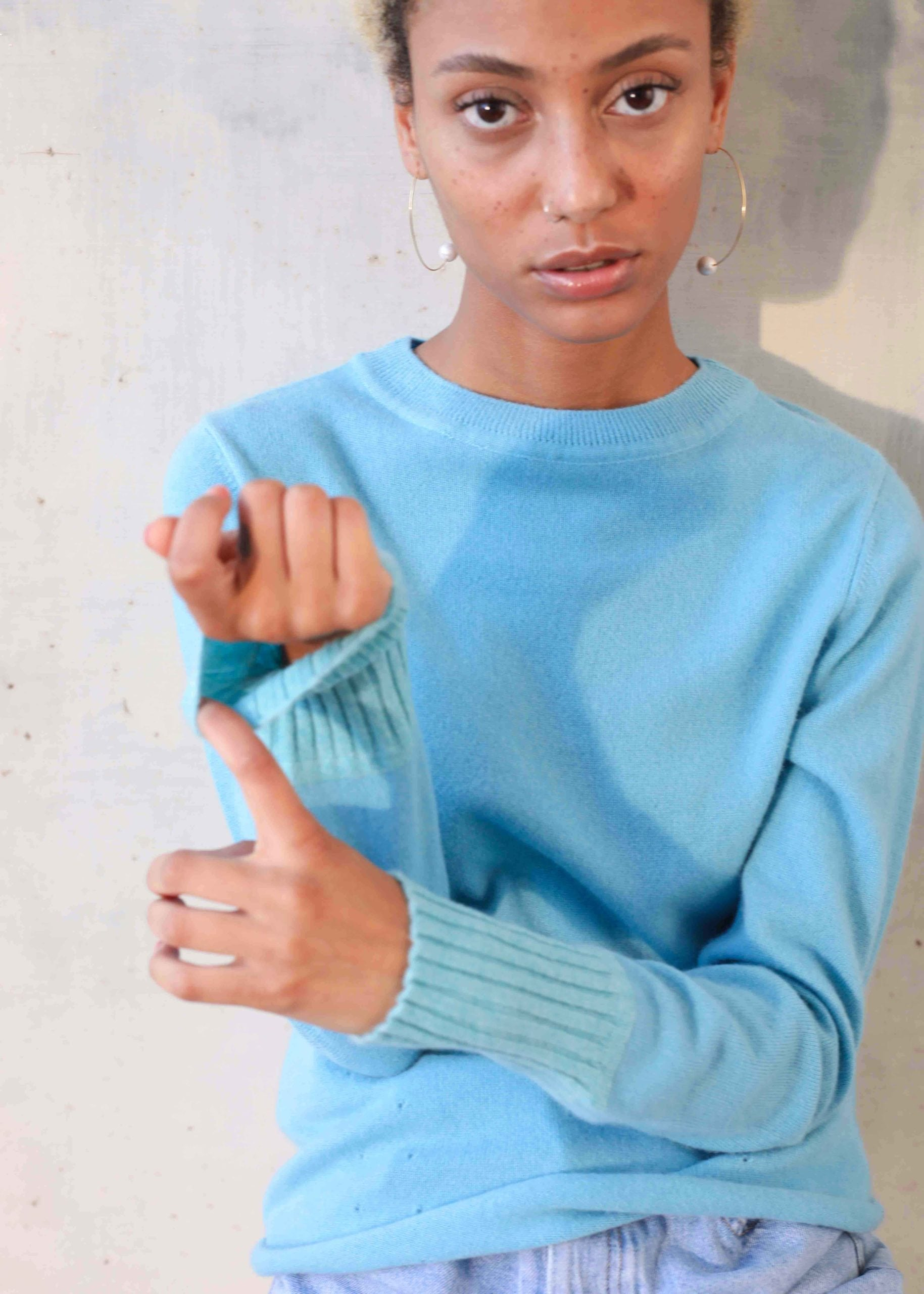 Model wearing blue cashmere sweater