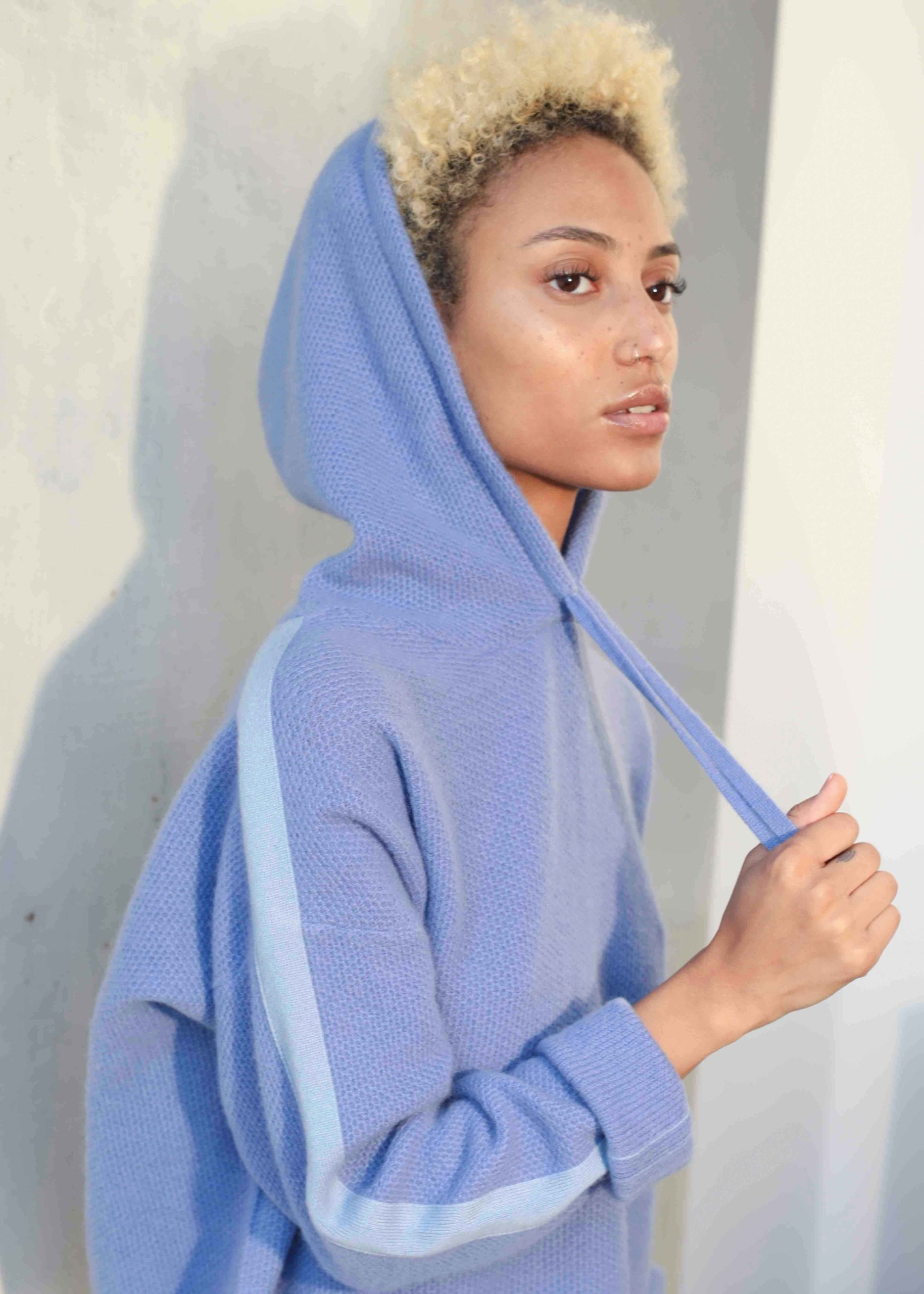 Model wearing blue hoodie
