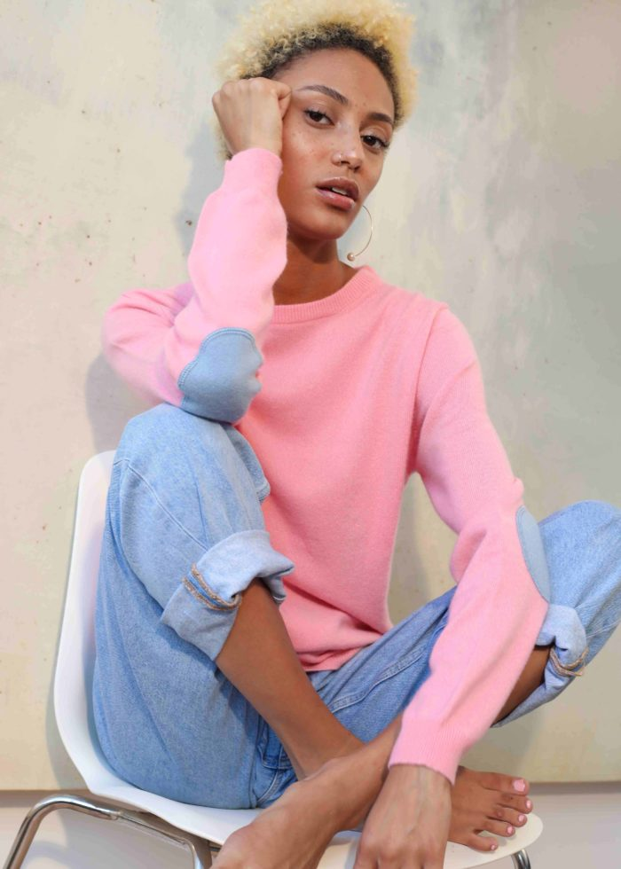 Model wearing pink cashmere sweater