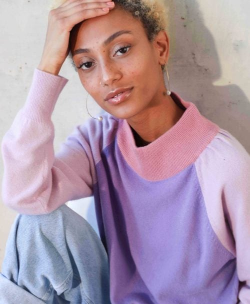 Model wearing purple sweater