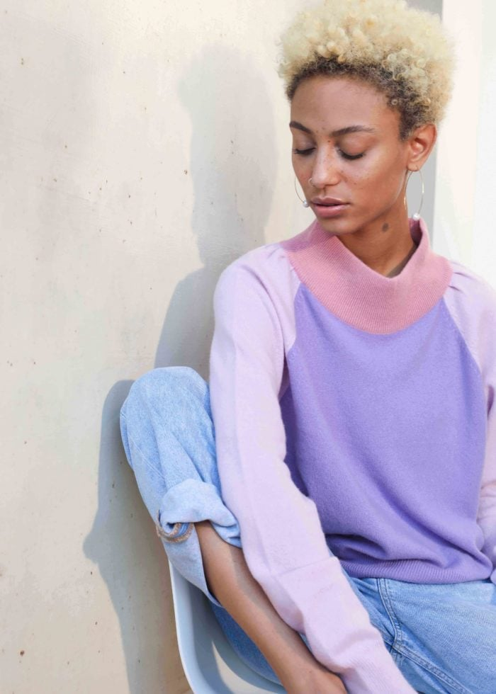 Model wearing 3 coloured sweater