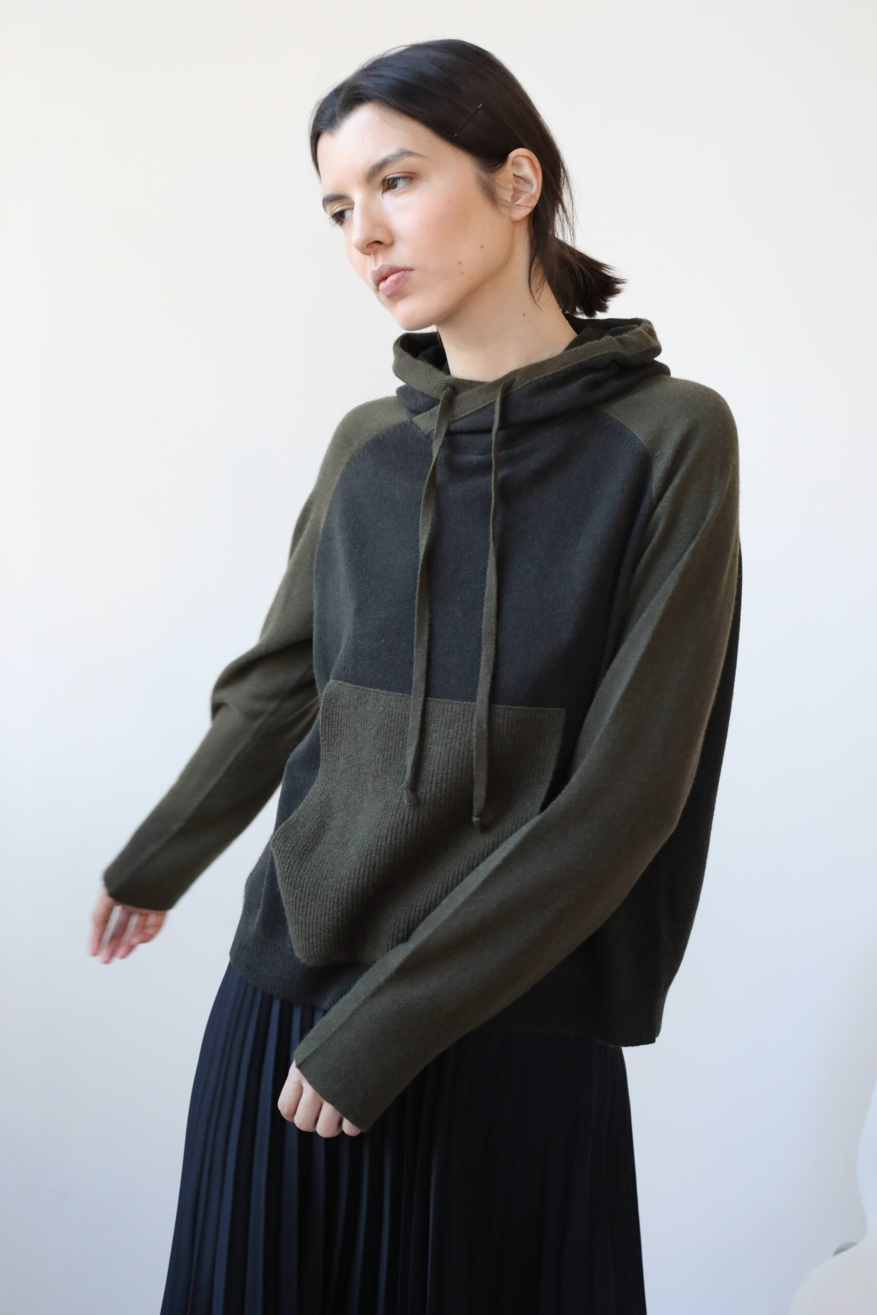 Girl in khaki green and brown cashmere hoodie